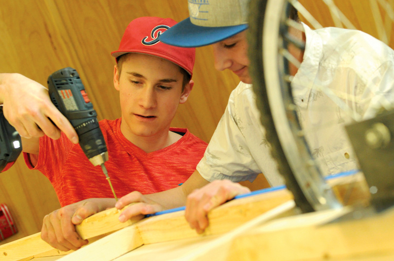Creston Homelinks students build bicycle campers for art project